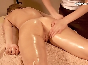 Elena being oil massaged by another woman