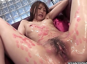 Street lamp dripped Asian slut engulfing on cocks and she loves the freakiness