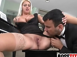 Busty neonate combines business with pleasure