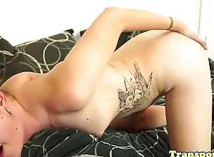 Buttplugged TS babe strokes her cock