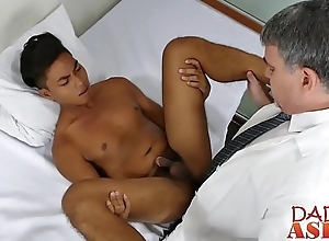 Handsome Asian twink gets his ass barebacked by sultry doctor